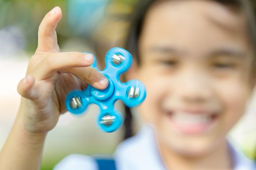 child with fidget spinner