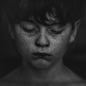 dark haired boy crying