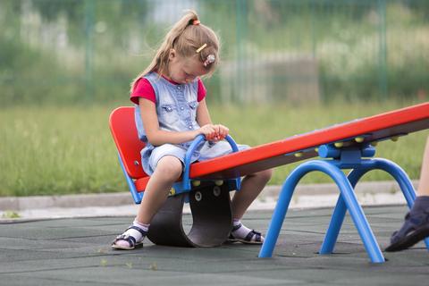 sulking girl on seesaw