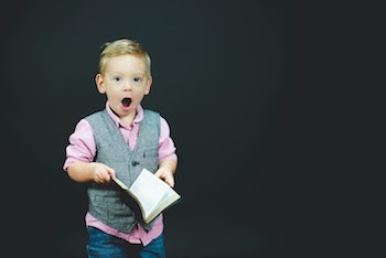excited boy with book