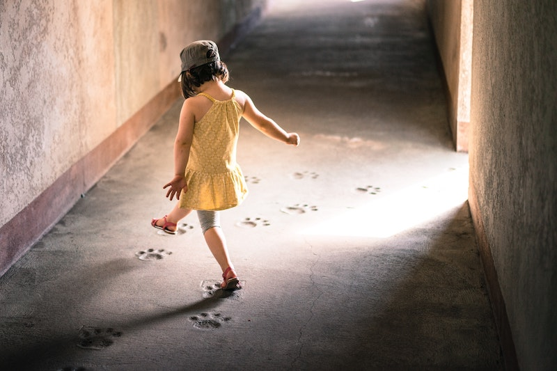 girl walking in footsteps