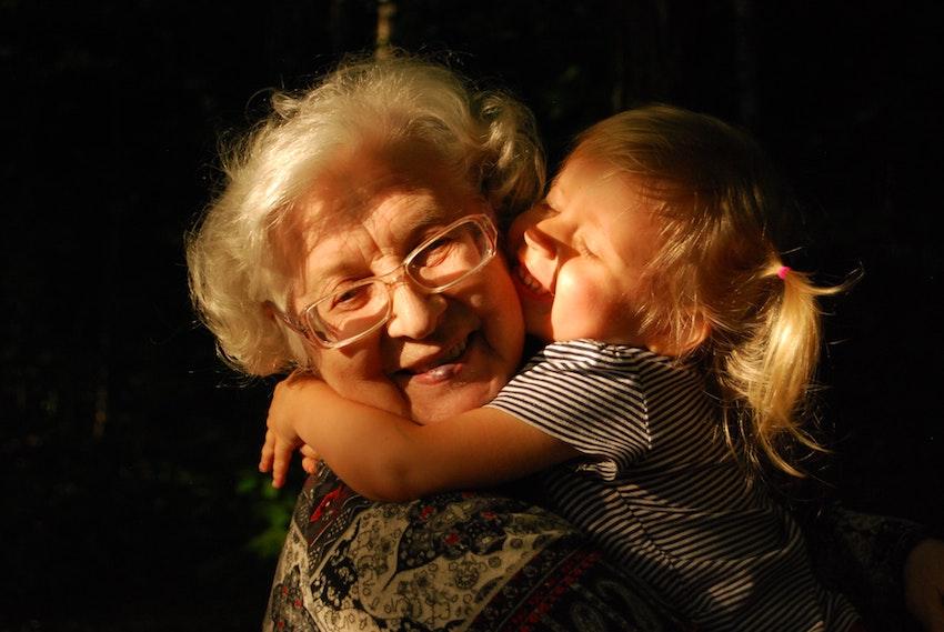 little girl hugging grandmother
